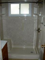 After: Seated Shower w/Travertine Walls & Listello Trim.