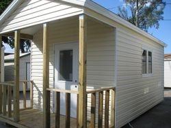 12x16 with 4 foot porch and custom door