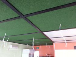 Construction of Synthetic Grass Panelling on ceiling.