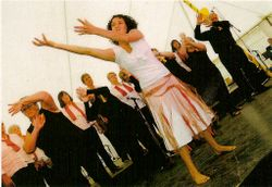 Young Aboriginal girl dancing and miming  the images of Black Saturday