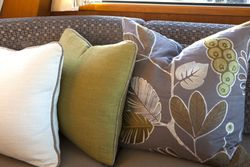 COORDINATING PILLOWS IN THE MAIN SALON