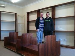 Cheryl and Son, Michael, laying out the new shelves he built