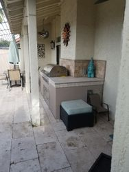 Old back patio tile and  fans