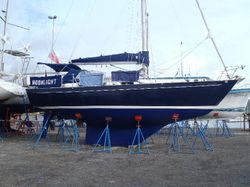 Hauled out - showing long fin and skeg configuration