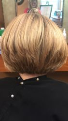 Back view, stacked angled bob with highlights