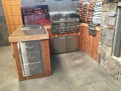 Built in grill w/ ice chest, burner, drawers, doors & rotisserie