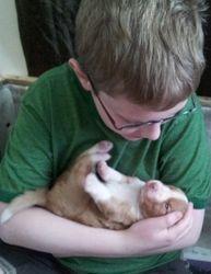 Kyle cuddle 3 week old puppy