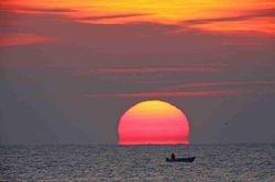 Alexandroupoli, Greece,gorgeously hued and misshaped Sun