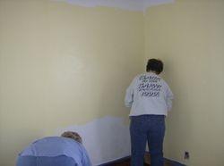Susan applies color to the ballroom walls