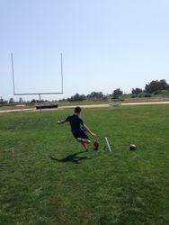 Bryce kicking the ball.