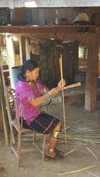 Woman splitting bamboo in neighboring village