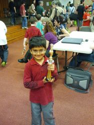 Aneesh with trophy he won at Shining Knights event