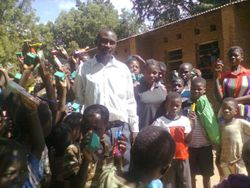 Children happy to receive toothbrushes, toothpaste and soap