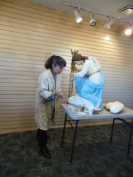 Teresa repainting angels that guard tabernacles