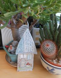 Tiny kantha stitched house
