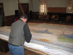 Ken works on the grand drape
