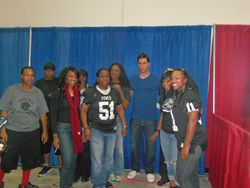Players pose with Brian Cushing