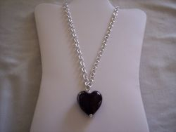 Chunky black foil lined heart on silvet plated chain