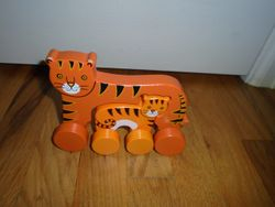 Wooden Rolling Interlocking Cats - $10