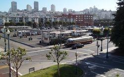 PCC #1077 passing the bus depot on Beach Street