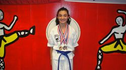 Amanda Martinez 2nd place fighting 2nd place breaking & 1st place forms