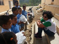Talking to the children after they received their supplies