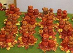Pumpkin people on fall leaves