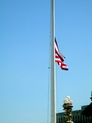 Close-Up of South Flag at Half Staff Outside West Façade of US Supreme Court Building from Northwest During Lying in Repose of Associate Supreme Court Justice Ruth Bader Ginsburg