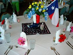 Texas boot centerpiece filled with Bluebonnets and the Yellow Rose of Texas