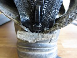 Glue new zip in place at the bottom and make sure it is in the centre
