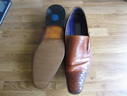 Repaired with new anti slip soles & rubber heels