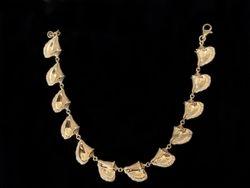 14k yellow gold conch bracelet with diamond edges