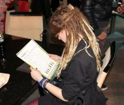 Engrossed in one of the leaflets