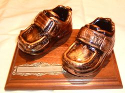 Pair of Bronze finished shoes on base