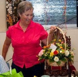 Pat admires her basket of flowers
