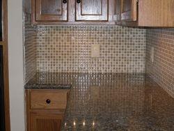 Ganite counter with Mosaik glass tile