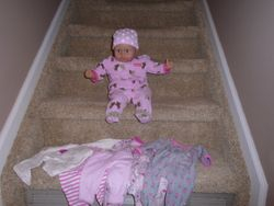 Soft Bodied Baby Doll with 4 sets of Real Baby Clothes - $25