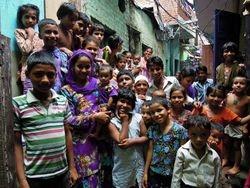 39  Children in the Sunder Nagari slum gather to see what's happening in their alleyway