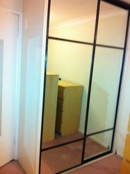 Light cream wardrobe and mirror doors