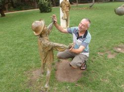John dancing with a statue in Cascais park