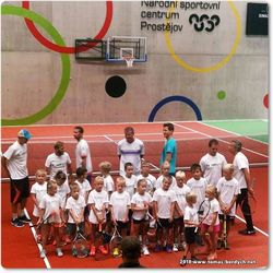 Tennis players and young fans