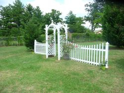 New white arbor and fence