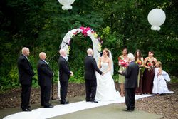The wedding arch is a great backdrop for the special ceremony