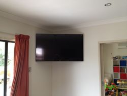 "60"" TV installed on wall bracket"