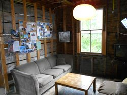 Lounge area with photos of past hikers
