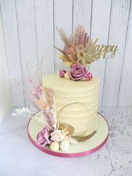 Pink and cream buttercream and dried flower birthday cake