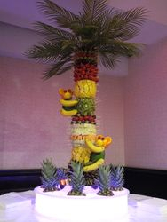 four foot fruit palm tree and two fruit monkeys.