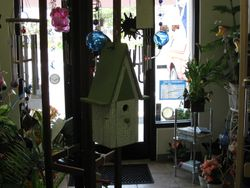 Hanging Wooden Birdhouses and Glass Hummingbird Feeders