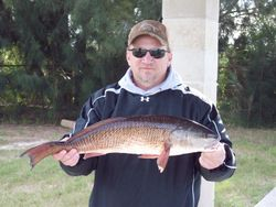 """Mark with a 27"""" redfish."""
