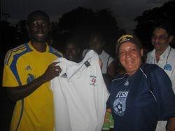 Barbara Presents FCSA shirt to Albion coach